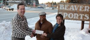 Rodney and Michele, representing the Fairbanks Rescue Mission, happily accept their check for the proceeds of Beaver Sports' 2015 Give Thanks Give Back donation campaign.